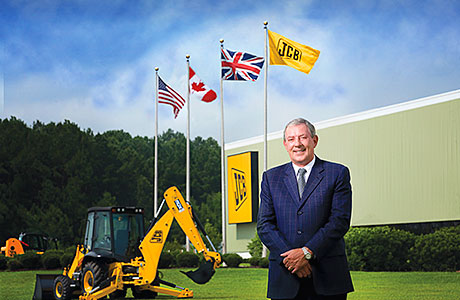 Scot who became JCB chief retires