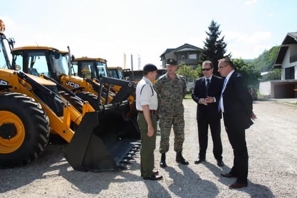 Backhoes aid Balkan flood efforts