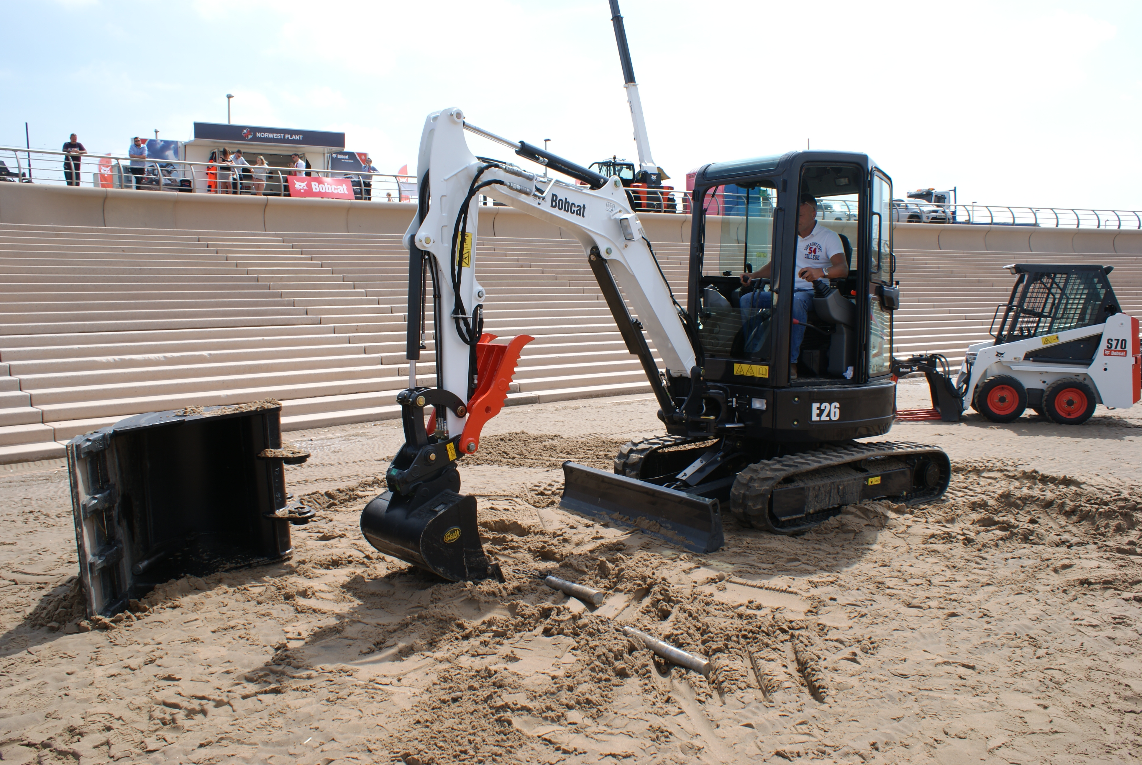 Bobcat attachments enjoy a day at the beach | Project Plant
